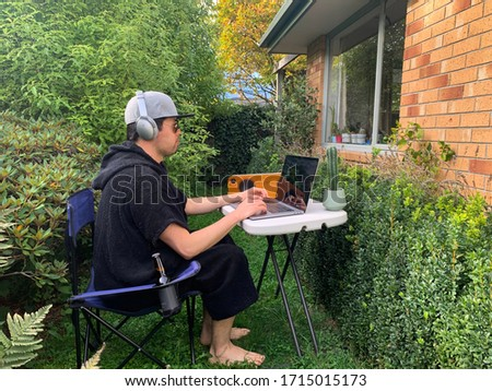 Hardworking man quarantined at home, relaxing outside of the house