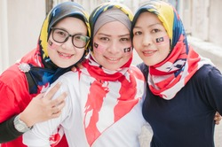 Hari Merdeka Malaysia National Day declared on 31 August every year annually. young women running happily holding Malaysian flag namely Jalur Gemilang