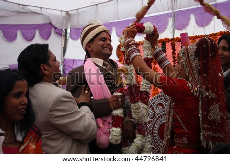 HARIDWAR, INDIA - JANUARY 14: Bride wears a wreath at the groom, which means their betrothal in a traditional Indian wedding, January 14, 2009 in Haridwar, India.