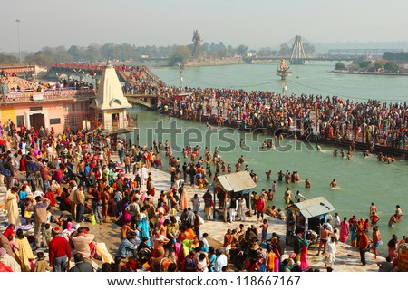 HARIDWAR, INDIA - JANUARY 14: Puja ceremony on the banks of Ganga, people celebrate Makar Sankranti, Jan 14, 2009 in Haridwar, India. Makar Sankranti huge Religious festival regarding Sun and Harvest. - stock photo