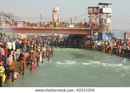 HARIDWAR, INDIA - JANUARY 14: Puja ceremony on the banks of Ganga river. People celebrate Makar Sankranti, huge Religious festival regarding Sun and Harvest, January 14, 2009 in Haridwar, India.