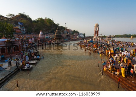 HARIDWAR, INDIA - MAY 20: Unidentified Hindus gather and take a ritual cleansing bath in the Ganges River for purification on May 20, 2009 in Hardiwar, India - stock photo