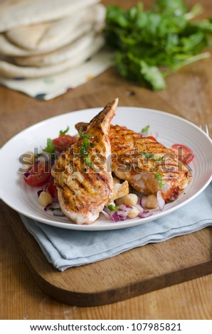 Harissa chicken with chickpea and tomato salad