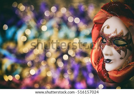 Harlequin carnival mask on colorful blur background #516157024