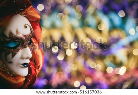 Harlequin carnival mask on colorful blur background #516157036