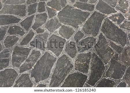 harmonic pattern of slate tiles at the floor