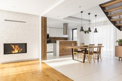 Harmonious open space with fireplace kitchen and dining area