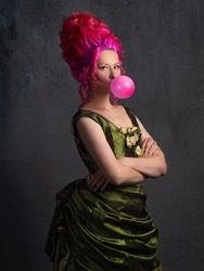 Harmony of contrasts, a fun concept of mixing old and new. Royal person in the style of old portraits with bright pink hair chewing gum