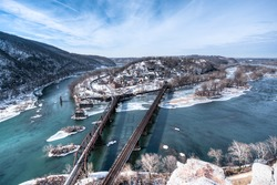Harpers Ferry, WV with snow on the ground and in the Shenandoah and Potomac river, shot from the Maryland Heights Overlook