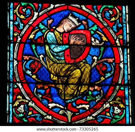 Harpist on a stained glass window in the Notre Dame cathedral in Paris, an element of the Tree of Jesse