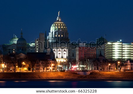 Harrisburg Pennsylvania Skyline at Night:  A view of Harrisburg, Pennsylvania's cityscape and state capital overlooking the Susquehanna River at night.