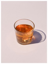 Harsh light through glasses, shadows. Clean minimalist contemporary art. Conceptual image. pastel clean colors. Pure water in glass. Simple visual concept.