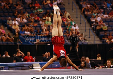 HARTFORD; CT - AUGUST 13: Gymnast Chris Brooks performs in the floor exercise during the men\'s competition at the VISA Nationals Gymnastics Championships on August 13, 2010 in Hartford, CT.