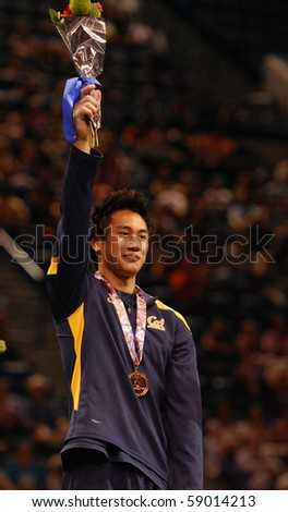 HARTFORD; CT - AUGUST 13: Gymnast Glen Ishino wins a bronze medal on the Pommel Horse event at the men's competition at the VISA Gymnastics Championships on August 13, 2010 in Hartford; CT