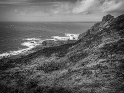 Hartland Point Lighthouse, North Devon, England. Black and white landscape.