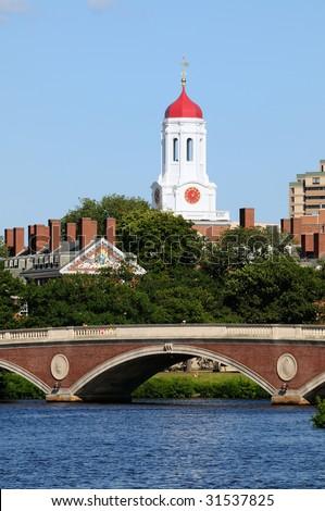 Harvard University and pedestrian bridge on Charles River, Cambridge, Massachusetts - stock photo
