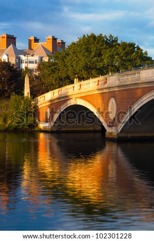 Harvard University bridge over the Charles River between Cambridge and Boston with beautiful reflections on the water below.  Copy space
