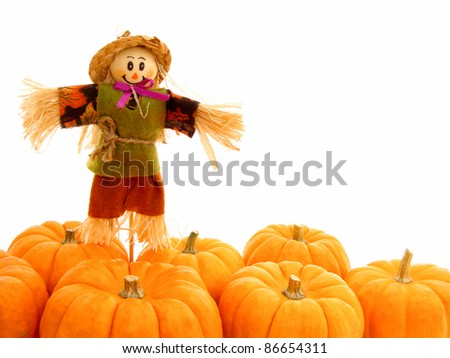 Harvest border of pumpkins with scarecrow over white