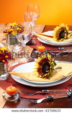 Harvest festive dinner table setting with sunflowers.