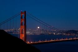 Harvest moon rises over the Goldengate Bridge