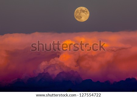 Harvest moon rising above storm clouds, southwestern Colorado