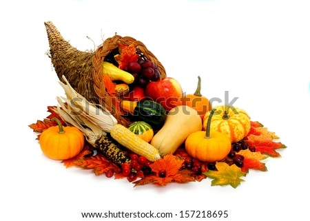 Harvest or Thanksgiving cornucopia filled with vegetables on a white background - stock photo