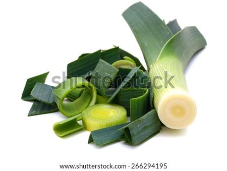 harvested freshly green leek sliced on white background #266294195