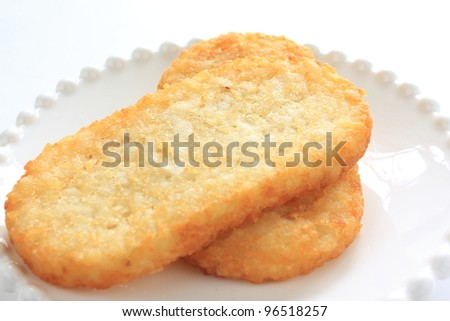 Hash brown on white background with copy space