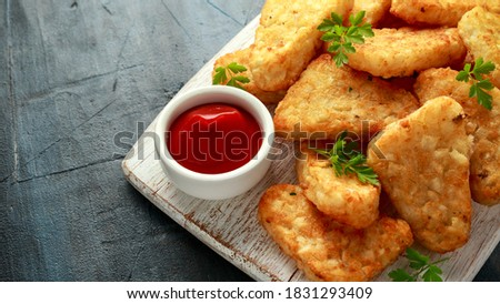 Hash brown potato with ketchup on white wooden board Stock photo ©