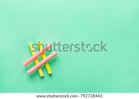 Hashtag Sign Made from Crossed Colorful Pink Yellow Chalks Crayons on Turquoise Background. Social Media Networking Blogging Concept. Female Girlish Funky Hipster Style. Pastel Colors Copyspace #792728443