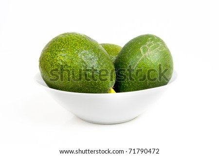 Hass Avocados in a bowl, isolated on white.
