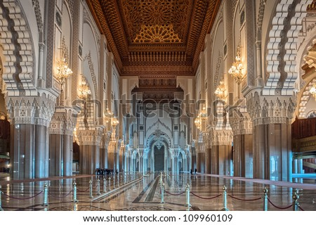 Hassan II Mosque interior corridor with columns in Casablanca Morocco. Arabic arches, ornaments, chandelier and lighting.