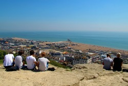 Hastings,East Sussex/UK 07/05/18 A beautiful Bank Holiday and a stunning view from the west hill, across the old town to the seafront, beach and English channel. Young people enjoy the scenery
