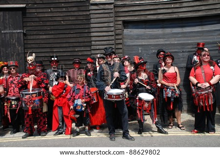 HASTINGS, ENGLAND - JULY 30: The Section 5 Drummers relax after a parade along the seafront at the Old Town Carnival Week on July 30, 2011 in Hastings, East Sussex, England. The carnival was founded in 1968.