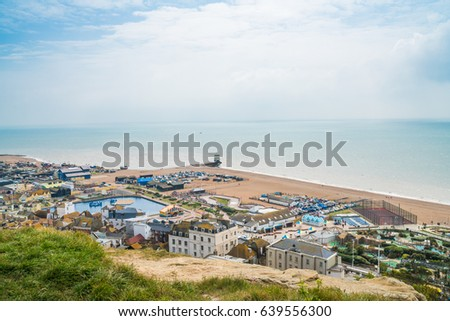 HASTINGS, UK - MAY 13 2017: View of seafront from  West Hill in Hastings, East Sussex, UK. The town is a popular seaside resort and a fishing port with a beach-based fishing fleet. #639556300