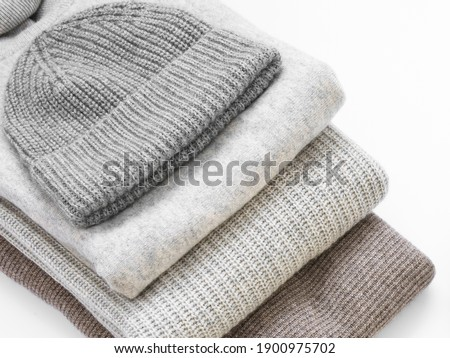 Hat and sweaters in a stack of warm cashmere Сток-фото ©