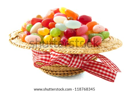 Hat filled with jelly beans isolated over white