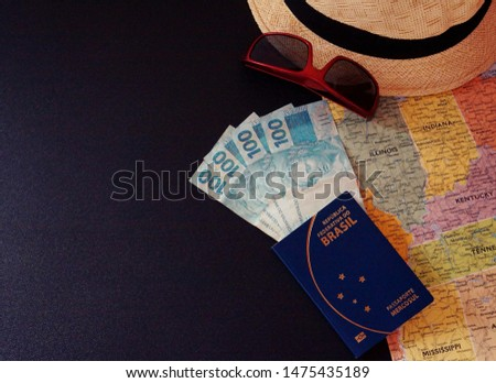 Hat, man sunglasses, map, brazilian passport and brazilian currency. Travel concept. Empty place for text.