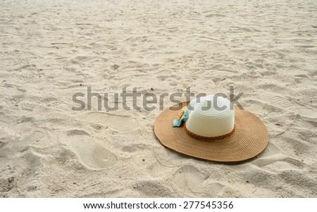hat on a tropical beach #277545356