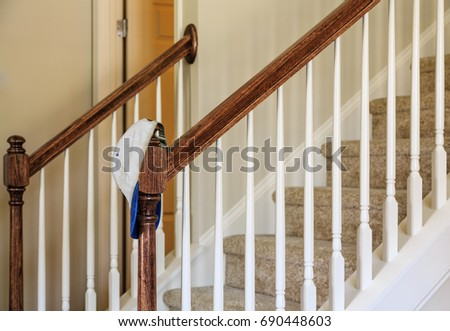 Hat on Banister by Stairs in New Home stock photo
