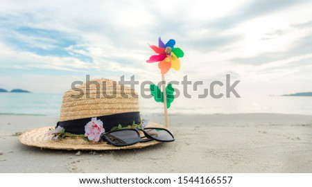 Hat sunglasses and windmill seaside summer seaside background