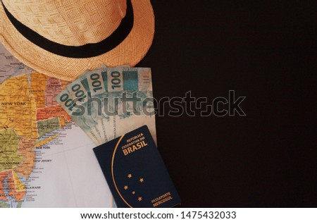 Hat, USA map, brazilian passport and brazilian currency, Real.