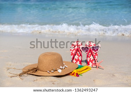 8d4eeeacff5f Flip flops and sunglasses on tropical beach with waves on background ...