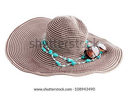 hat with sunglasses and jewelry of turquoise