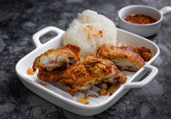 Hat-yai fried chicken is a local southern thai food from country named 'Hat-yai'. Their signature is topping on fried chicken with fried shallots.