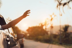 Hatchback Car travel driving road trip of woman summer vacation in blue car at sunset,Girls happy traveling enjoy holidays and relaxation with friends together get the atmosphere and go to destination
