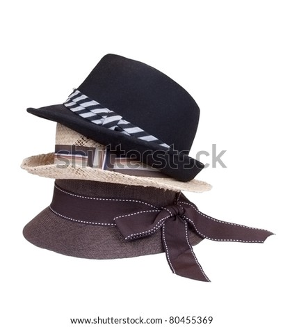 Hats in stack isolated on white background