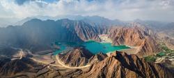 Hatta Dam Lake in mountains enclave region of Dubai, United Arab Emirates aerial panoramic view