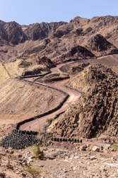 Hatta Wadi Hub mountain carting downhill trail with car tires barrier, Hajar Mountains, United Arab Emirates.