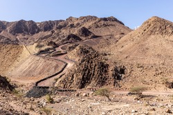 Hatta Wadi Hub mountain carting downhill trail with car tires fence, Hajar Mountains, United Arab Emirates.